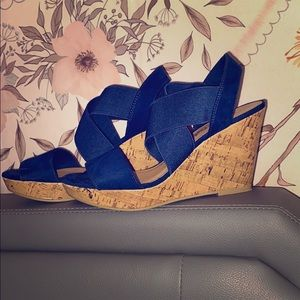 These are a navy pair of wedges. Wedge: 3 1/2""